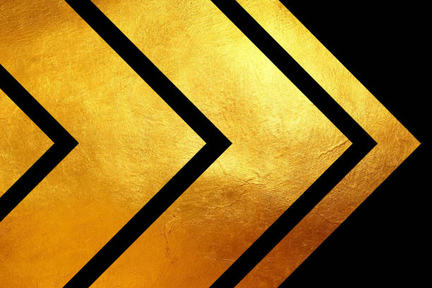 Creative digital abstract shiny golden texture on black background. stock photo