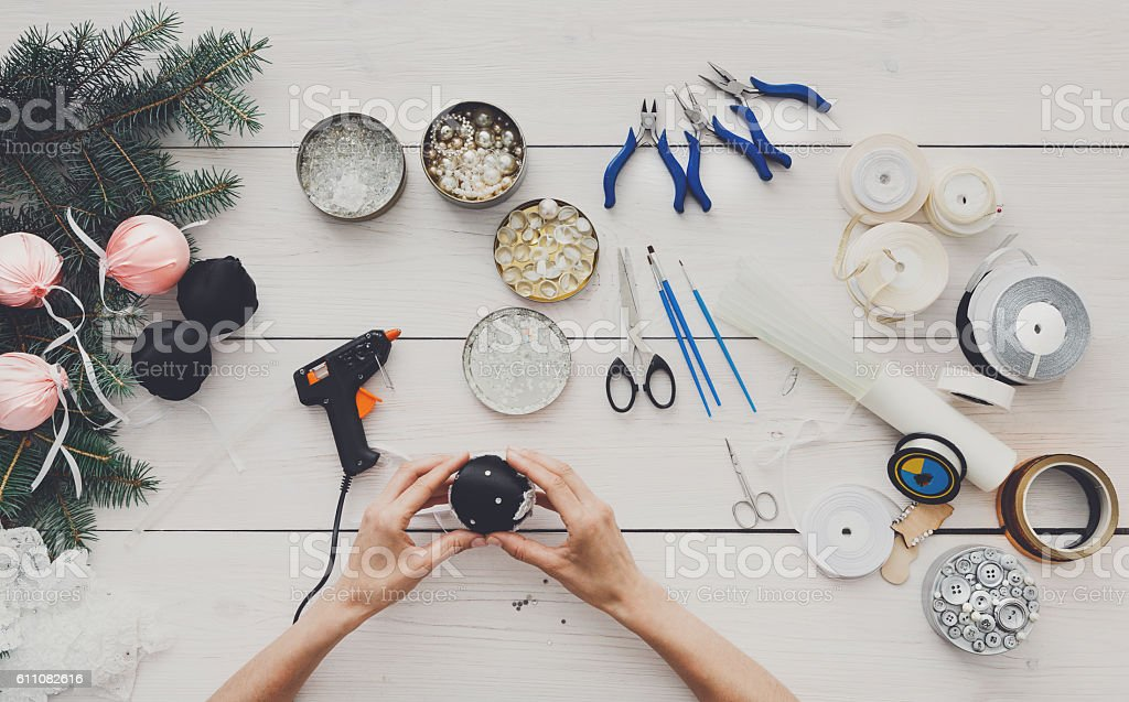 Creative diy hobby. Handmade christmas decoration, balls and garland stock photo