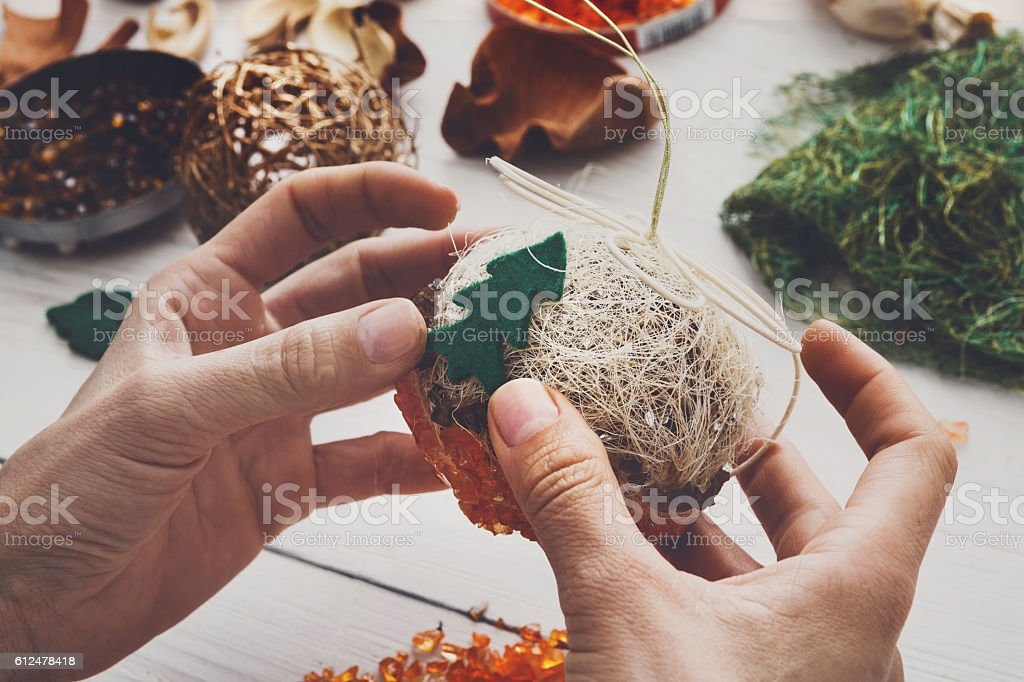 Creative diy hobby. Handmade craft christmas decoration, balls a stock photo