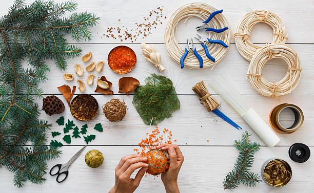 creative diy hobby. handmade craft christmas decoration, balls and garland - winterdeko basteln stock-fotos und bilder