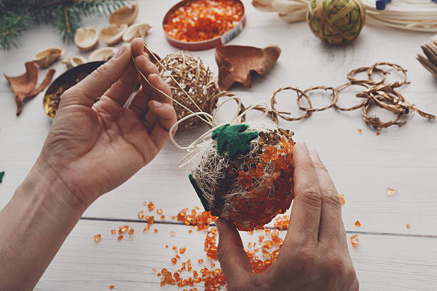 creative diy hobby. handmade craft christmas decoration, balls and garland - diy xmas stock-fotos und bilder