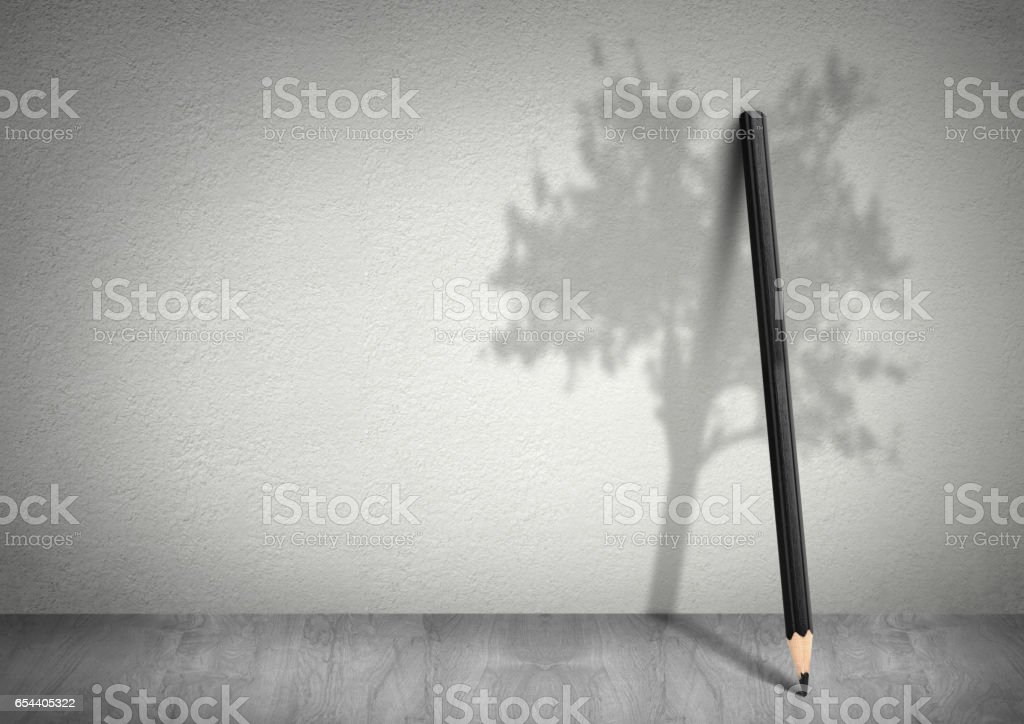 Creative ecology concept, pencil with shadow of tree with copy space stock photo