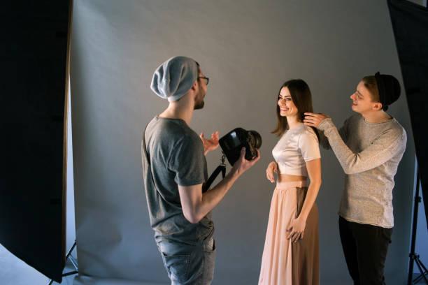 Creative fashion team work with model stock photo