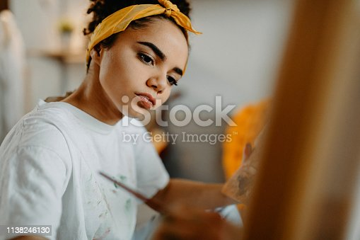 istock Creative female artist painting new picture 1138246130