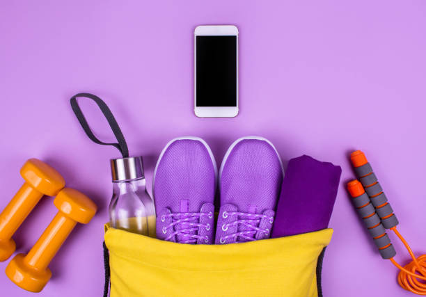 creative flat lay of sport and fitness equipments on yellow background with copy space. - exercise equipment stock photos and pictures