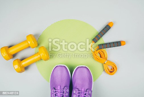 istock Creative flat lay of sport and fitness equipments 882448124