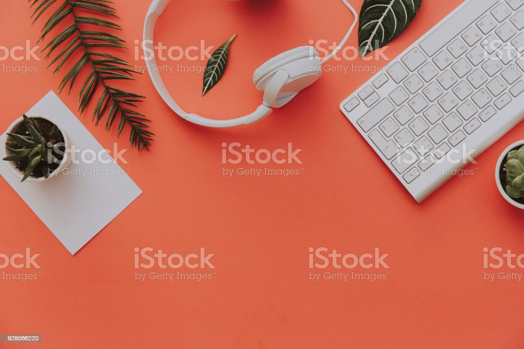 Creative flat lay of workspace desk, office stationery, keyboard,...