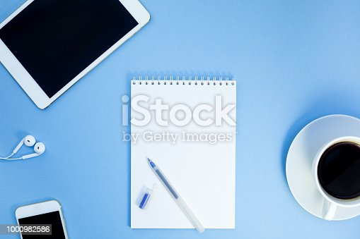 istock Creative flat lay photo of workspace desk 1000982586