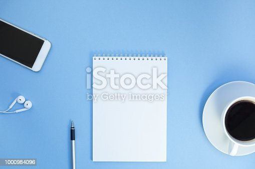 istock Creative flat lay photo of workspace desk 1000984096