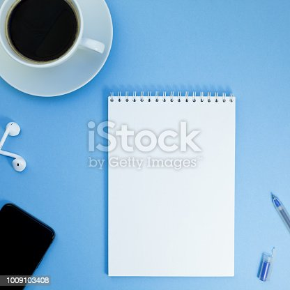 istock Creative flat lay photo of workspace desk 1009103408