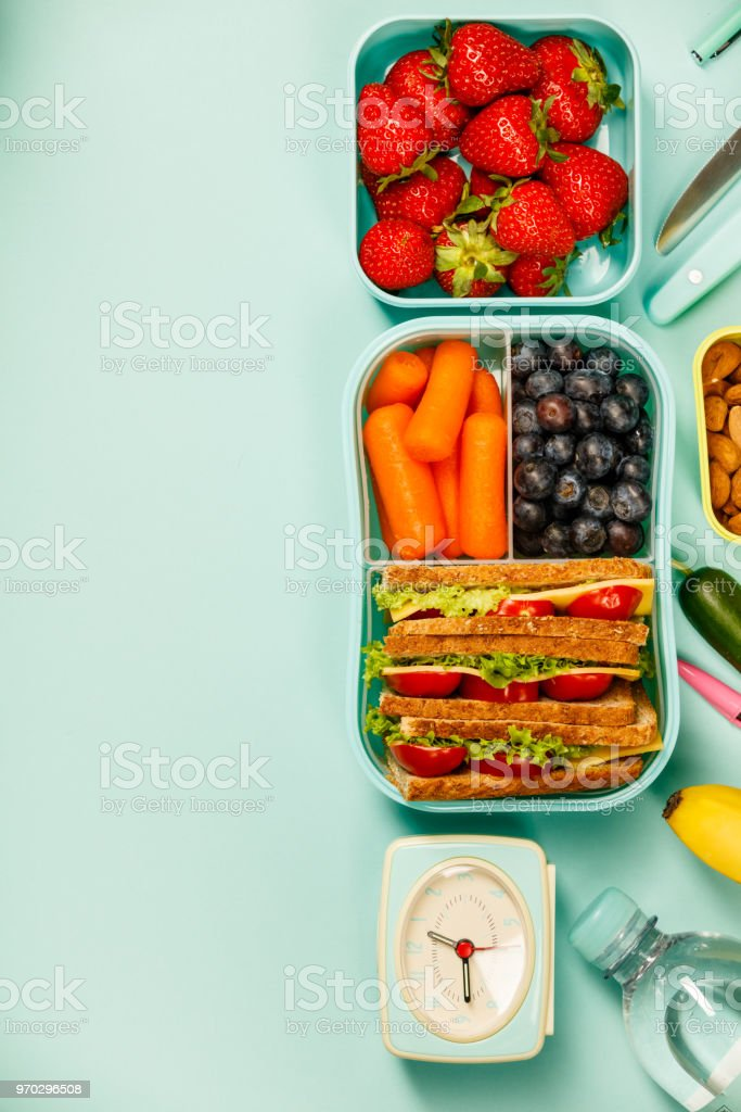 Creative flat lay with healthy lunch and office or school supplies stock photo