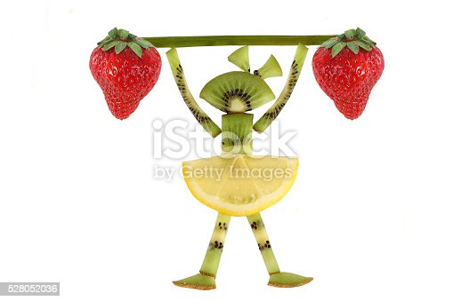 istock Creative food concept. Funny little girl  with slices of kiwi. 528052036