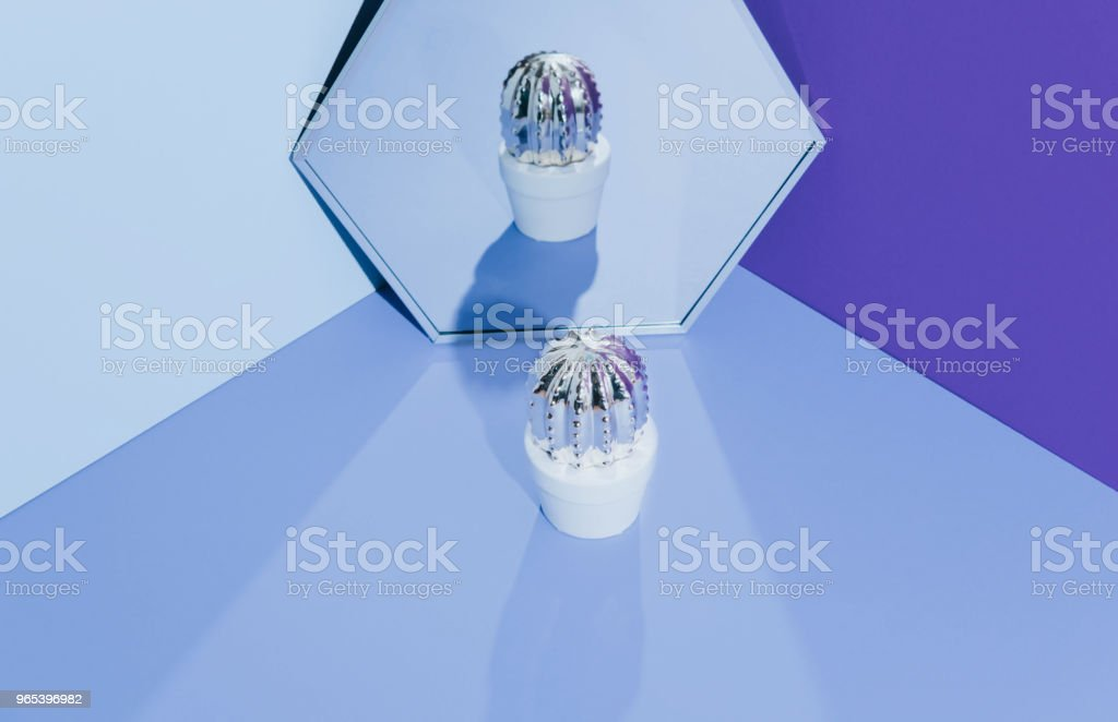 Creative golden cactus on ultraviolet background royalty-free stock photo