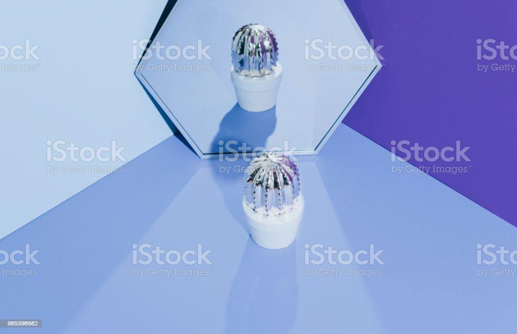 Creative golden cactus on ultraviolet background zbiór zdjęć royalty-free