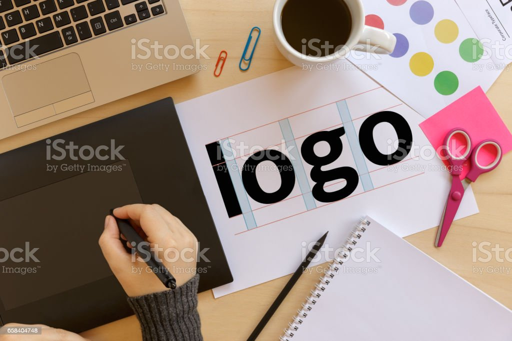 Creative graphic designer using a graphics tablet at work stock photo
