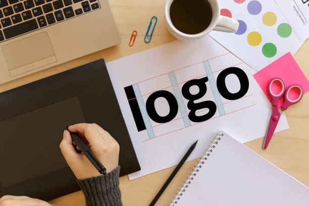 creative graphic designer using a graphics tablet at work - logo design stock photos and pictures