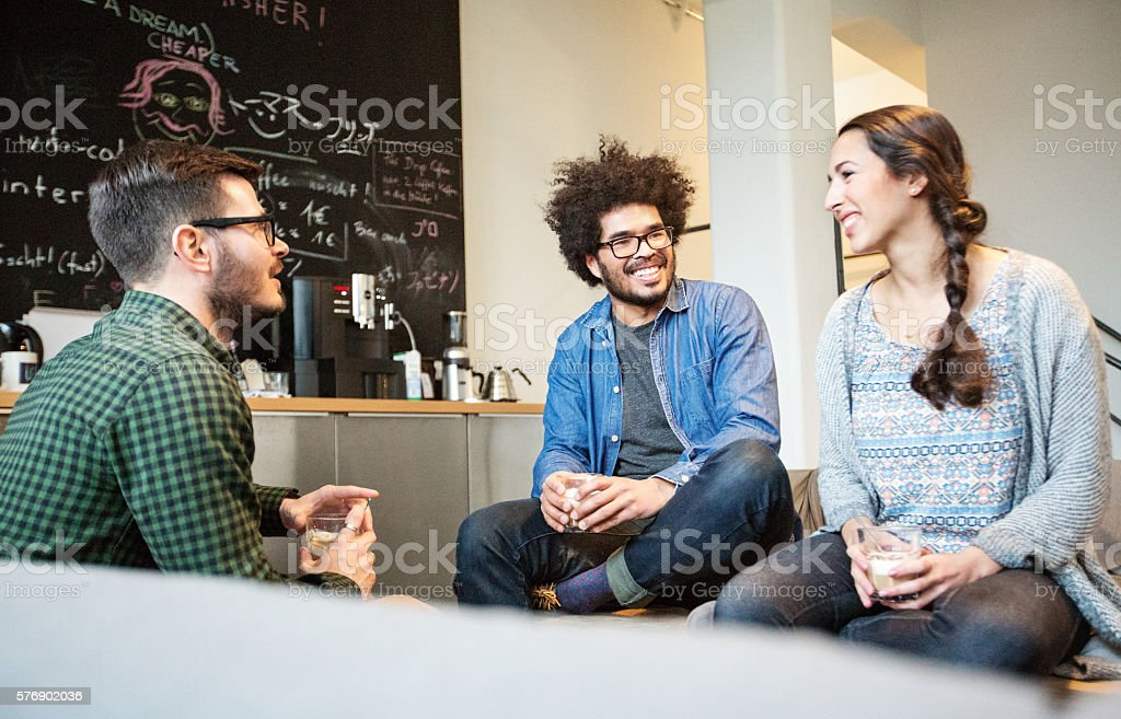 Creative group of people having a coffee break stock photo