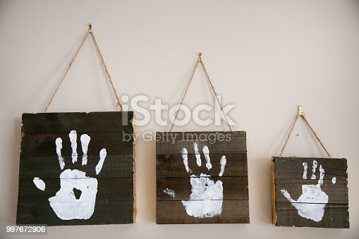 Creative White Handprint Interior Family Wall Hangings in a Row