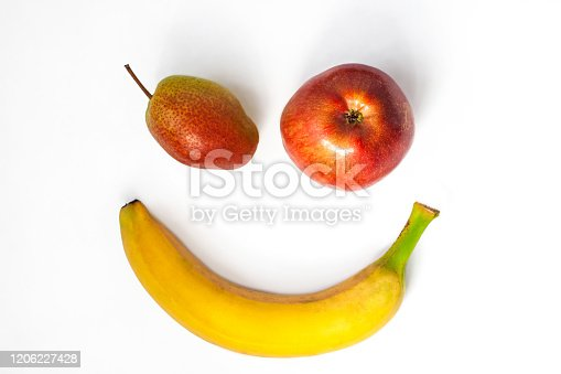 1176496357 istock photo Creative healthy breakfast concept on a white background flat lay. Fresh banana, apple, pear fruits with natural shadow. 1206227428