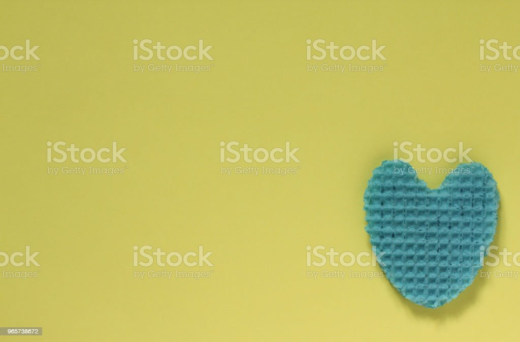 Creative heart from an edible wafer in blue pastel  color. Abstraction. - Royalty-free Blue Stock Photo