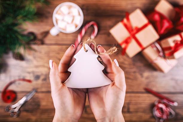 creative hobby. woman's hands show christmas holiday handmade christmas tree - bastelkarton stock-fotos und bilder