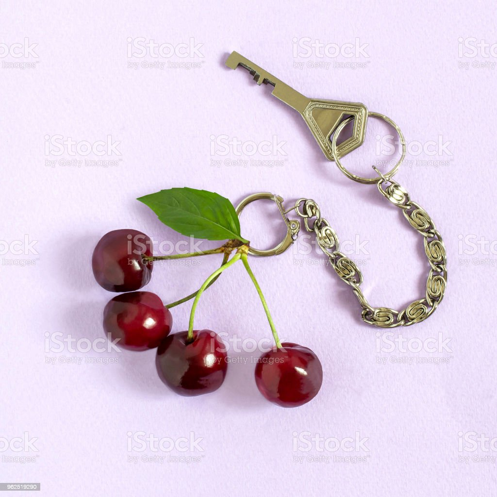Creative idea: cherry as keychain with key - Royalty-free Art Stock Photo