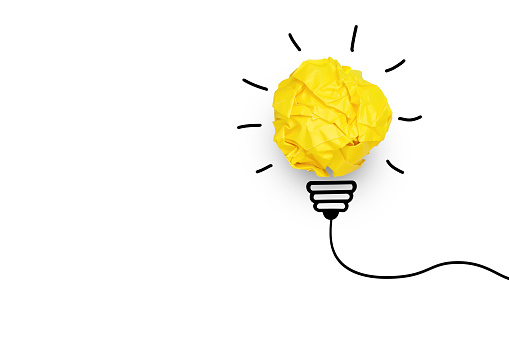 Creative idea. Concept of idea and innovation with yellow paper ball on white background, copy space