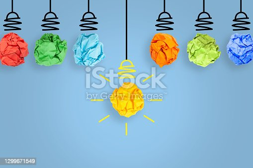 istock Creative Idea Concepts Light Bulb Crumpled Blue Paper on White Background 1299671549