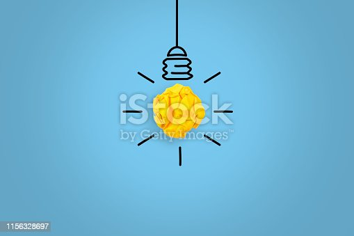 To remind the importance of innovation in the business world. Businessman holds in his hand a light bulb. New idea in human palm. To be ordinary or different. Innovation brings success. Creative Idea Concepts Light Bulb Crumpled Yellow Paper on Blue Background.