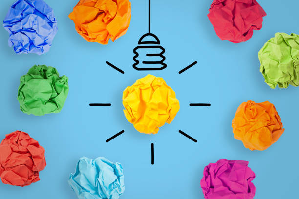 Creative Idea Concepts with Light Bulb Crumpled Paper on Blue Background stock photo