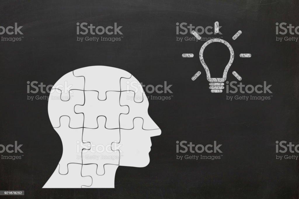 Creative idea light bulb head puzzle think stock photo