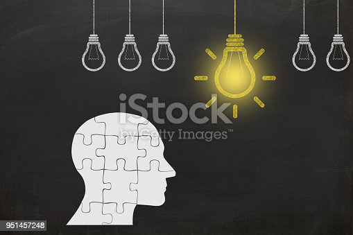 istock Creative idea light bulb head puzzle think 951457248