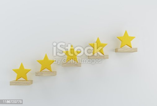 istock Creative idea of yellow five star shape on white wall. The best excellent business services rating for satisfaction. 1186720775