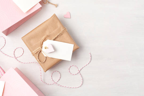 Creative image of gift bag and box with empty tag heart and christmas picture id1067990088?b=1&k=6&m=1067990088&s=612x612&w=0&h=9lpeoiehabwe w9yeo4tpsuzrpipuw3hnppqfhrhh6i=