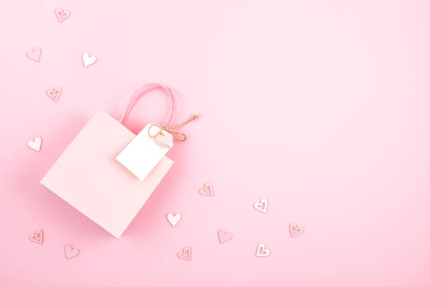Creative image of gift bag and box with empty tag heart and christmas picture id1067990102?b=1&k=6&m=1067990102&s=612x612&w=0&h=rs4ckfeebxuz3tq2gxf5uemrqapjvnc 3r hoqlzrvw=