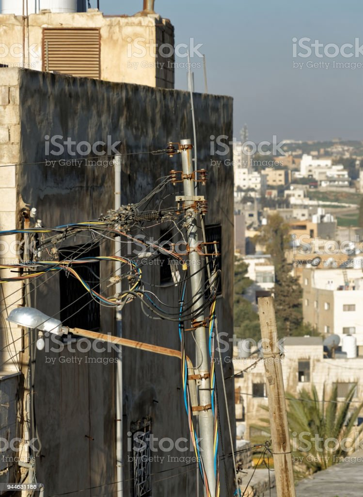 Creative laying of above-ground electrical cables in Madaba stock photo