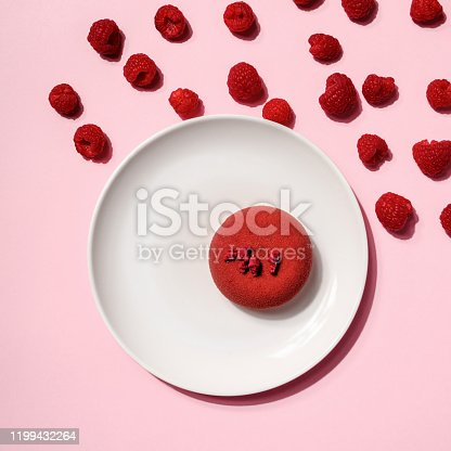 istock Creative layout made of Cheesecake with Raspberry berry in hard light on colorful pink background. Hard shadow, minimal flat lay style. Food concept. Fruit pattern top view. 1199432264