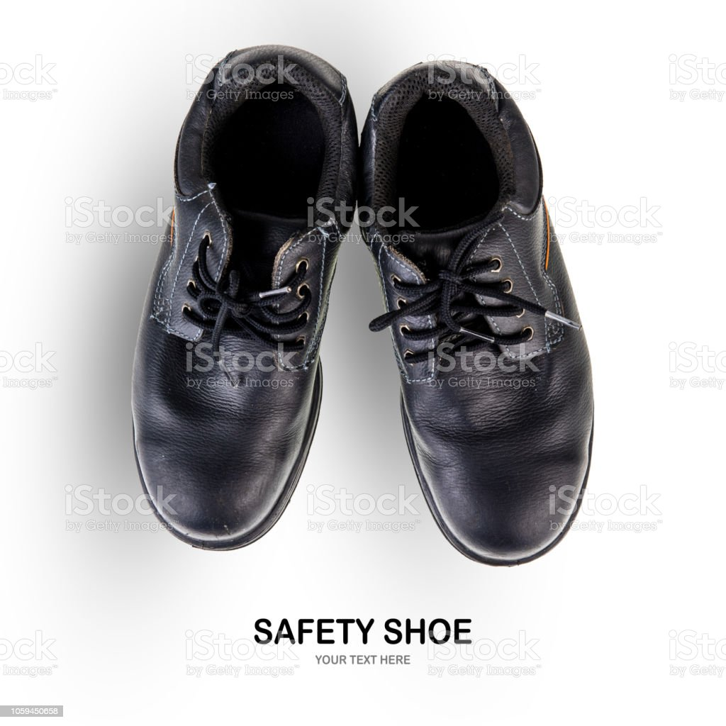 Creative layout made of Old and dirty safety shoe black work boots on...
