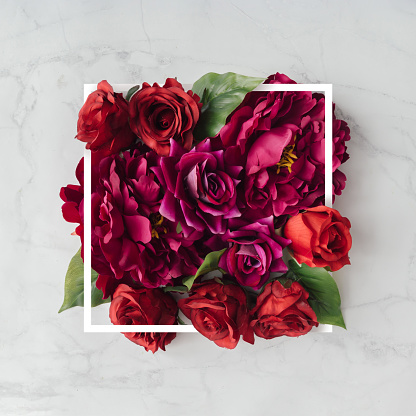 istock Creative layout made with flowers and white frame. Spring minimal concept. Nature background. 910887528