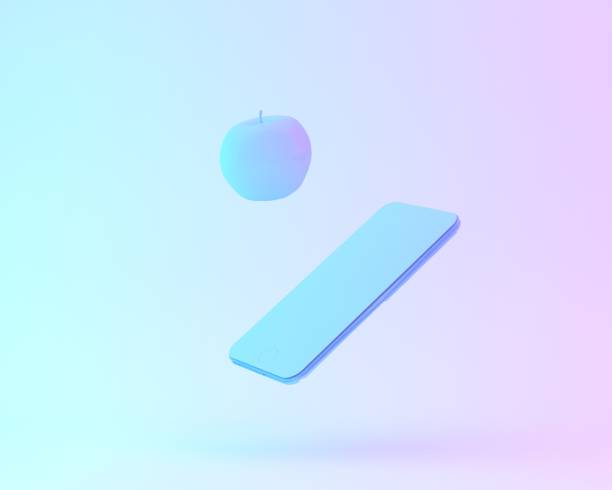 Creative layout of apple with smartphone painted in white and vibrant bold gradient purple and blue holographic color lights background. minimal office concept. surrealism art. stock photo