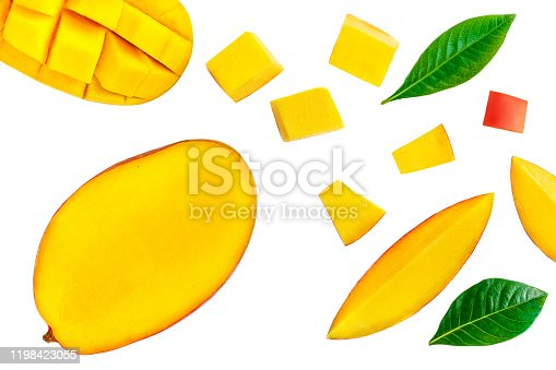 Creative layout of mango fruit with pieces and green leaves isolated on a white background. Mango Pattern. Top view. Flat lay
