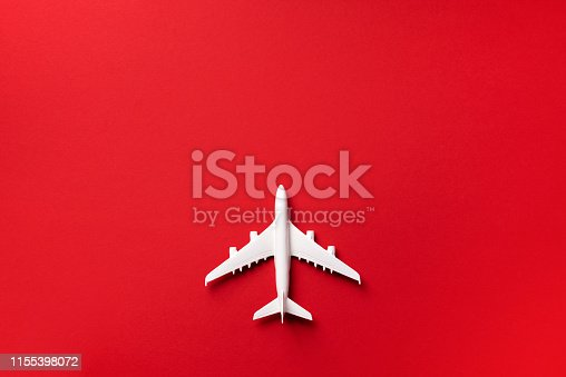 istock Creative layout. Top view of white model plane, airplane toy on pink pastel background. Flat lay with copy space. Summer trip or travel concept 1155398072