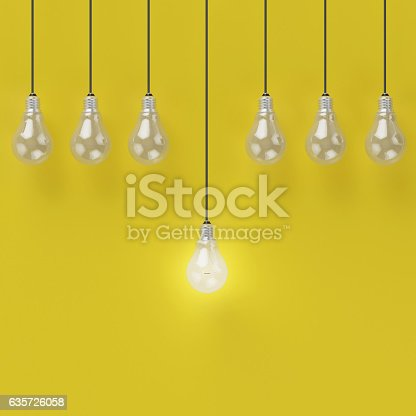 istock Creative light bulb Idea concept on yellow background 635726058
