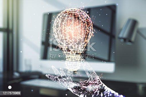 istock Creative light bulb illustration on modern computer background, future technology concept. Multiexposure 1217575969