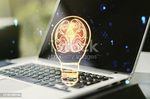 istock Creative light bulb illustration with human brain on modern computer background, future technology concept. Multiexposure 1216108185