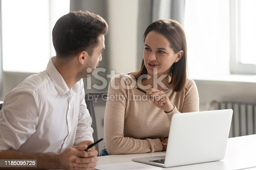 1085713886istockphoto Creative male and female colleagues talking at work share ideas 1185095725