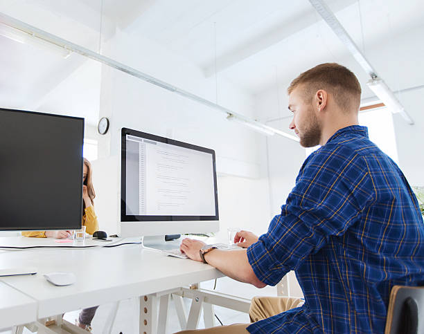 creative man or programmer with computer at office stock photo