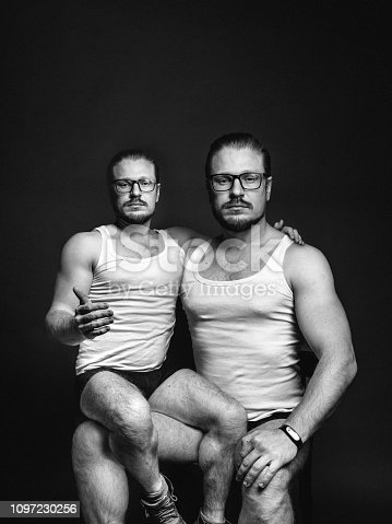 Creative male portrait. The concept of cloning people. Black and white image with scratches
