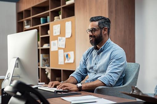 Creative man working on computer