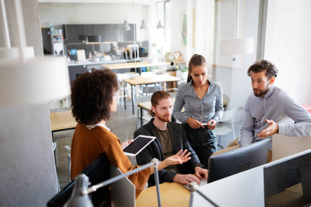 Creative managers crew working with new startup project in office. Team brainstorming. stock photo